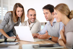 Group of schoolmates in business training Stock Photography
