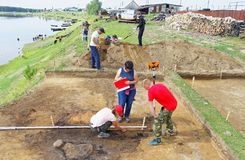 A group of scientists is conducting archaeological excavations in siberian village. Editorial.Nyaksimvol village Beryozovsky district of the Khanty-Mansiysk Royalty Free Stock Photo