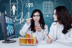Group of scientists doing experiment Royalty Free Stock Photography