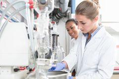 Group of scientists with gloves and gowns in laboratory Stock Image