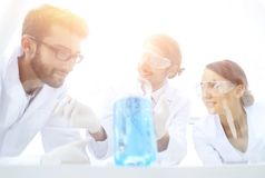 Group of scientists working on an experiment at the laboratory stock photos