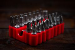 Collection of screwdriver bits in red stand royalty free stock images