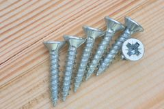 Group of screws on wood Royalty Free Stock Photography
