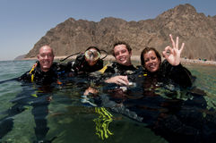 Group of scuba divers on surface Royalty Free Stock Images