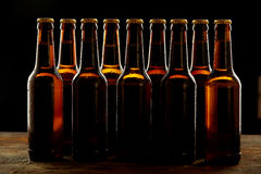 Group of sealed unlabelled brown beer bottles Royalty Free Stock Images