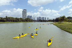Group of secondary school children learn kayaking at Singapore river. Young teens enjoy while taking kayaking lesson on a sunny day Royalty Free Stock Photo