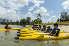Group of secondary school children learn kayaking at Singapore river. Royalty Free Stock Photo