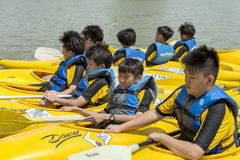 Group of secondary school children learn kayaking at Singapore river. Young teens enjoy while taking kayaking lesson on a sunny day Royalty Free Stock Photography