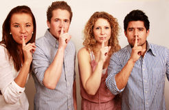 Group secret with finger on lips Stock Photos