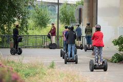 Group of segway riders stock photos