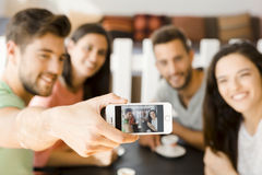 Group selfie at the coffee shop. Group of friends at the coffee shop making a selfie together Stock Photo