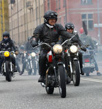Group of senior bikers on old fashioned motorcycles Stock Images