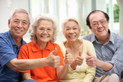 Group Of Senior Chinese Friends Relaxing At Home Royalty Free Stock Image