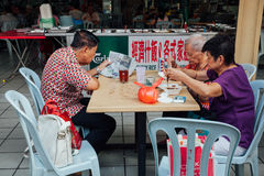 Group of senior Chinese people having a breakfast in traditional Royalty Free Stock Images