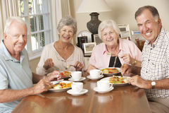 Group Of Senior Couples Enjoying Meal Together Royalty Free Stock Photos