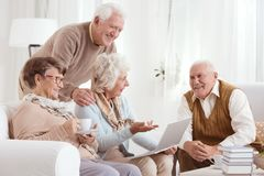 Group of senior friends converses royalty free stock photo