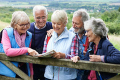 Group Of Senior Friends Hiking In Countryside. Portrait Of Senior Friends Hiking In Countryside Stock Photo