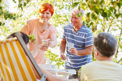 Group of senior friends making a party with fruits Royalty Free Stock Image