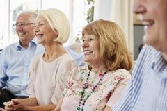 Group Of Senior Friends Relaxing On Sofa At Home stock photography