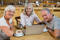 Group of senior friends using laptop Royalty Free Stock Image