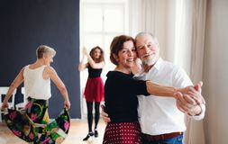 Group of senior people in dancing class with dance teacher. royalty free stock image