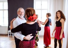 Group of senior people in dancing class with dance teacher. stock photo