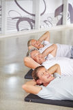 Group of senior people doing crunches Stock Photo