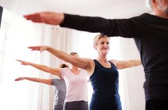 Group of senior people doing exercise in community center club. royalty free stock photography