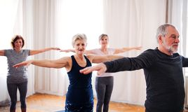 Group of senior people doing exercise in community center club. Group of active senior people doing exercise in community center club royalty free stock images