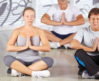 Group of senior people meditating Stock Images