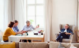 Group of senior people playing board games in community center club. stock photography