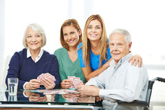 Group of senior people playing cards Royalty Free Stock Photo