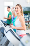 Group with senior people on treadmill in gym Stock Photo