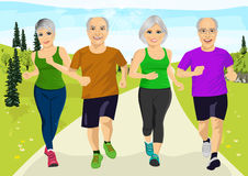 Group of senior runner men and women running together. Outdoors Royalty Free Stock Photos