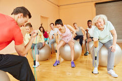 Group with senior training with expanding band Stock Photography