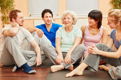 Group and senior woman in yoga class royalty free stock image