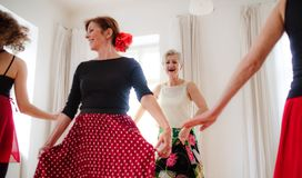 Group of senior women in dancing class with dance teacher. stock image