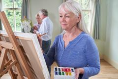 Group Of Seniors Attending Painting Class With Teacher royalty free stock photos