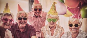 Group of seniors celebrating a birthday royalty free stock image