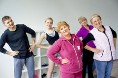 Group of seniors doing exercises Royalty Free Stock Photo