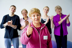 Group of seniors doing exercises Royalty Free Stock Image