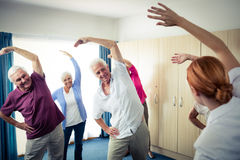 Group of seniors doing exercises with nurse Stock Images