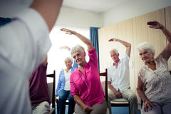 Group of seniors doing exercises with nurse Stock Photos