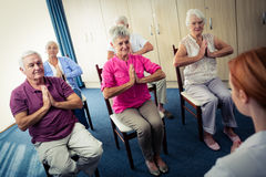 Group of seniors doing exercises with nurse Royalty Free Stock Photos