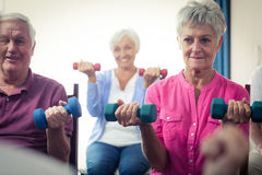 Group of seniors doing exercises with nurse Stock Photo