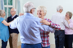 Group Of Seniors Enjoying Dancing Club Together. Seniors Enjoying Dancing Club Together Royalty Free Stock Photo