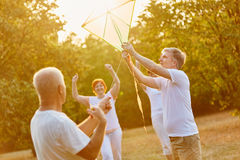 Group of seniors kite flying as a team Royalty Free Stock Images