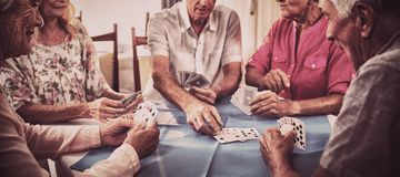 Group of seniors playing cards stock photo