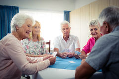 Group of seniors playing cards Stock Image