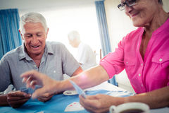 Group of seniors playing cards stock photography
